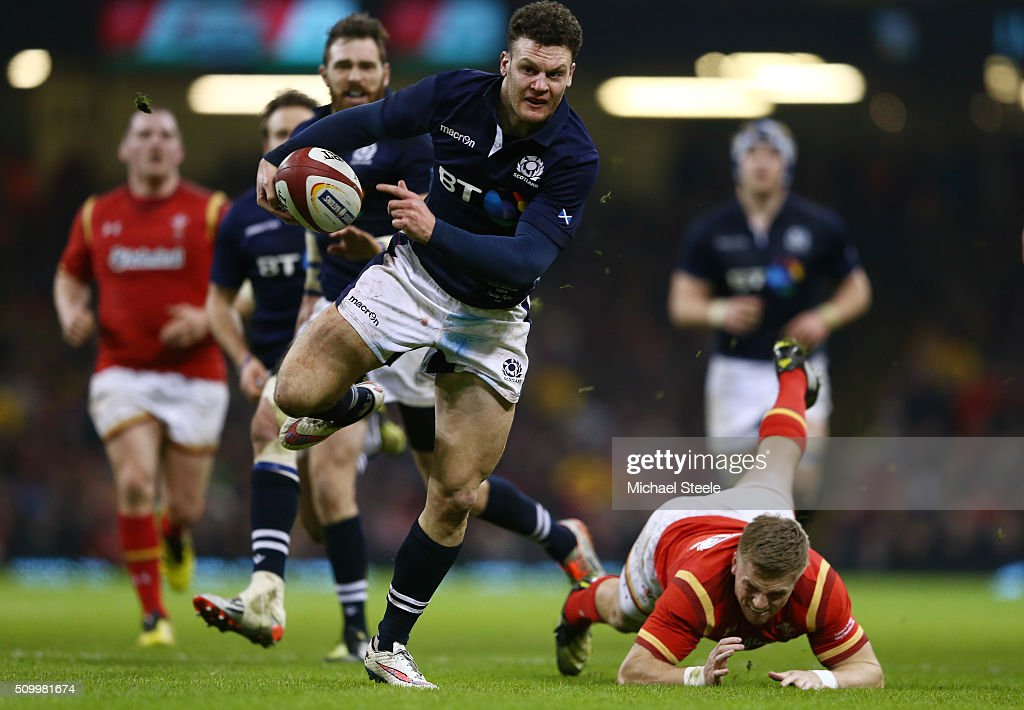 Duncan Taylor of Scotland wrong foots <a gi-track='captionPersonalityLinkClicked' href=/galleries/search?phrase=Gareth+Anscombe&family=editorial&specificpeople=7078759 ng-click='$event.stopPropagation()'>Gareth Anscombe</a> of Wales to score his team's second try during the RBS Six Nations match between Wales and Scotland at the Principality Stadium on February 13, 2016 in Cardiff, Wales.