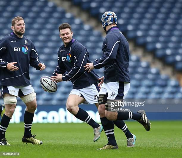 Duncan Taylor runs with the ball during the Scotland captain's run at Murrayfield Stadium on February 5 2016 in Edinburgh Scotland
