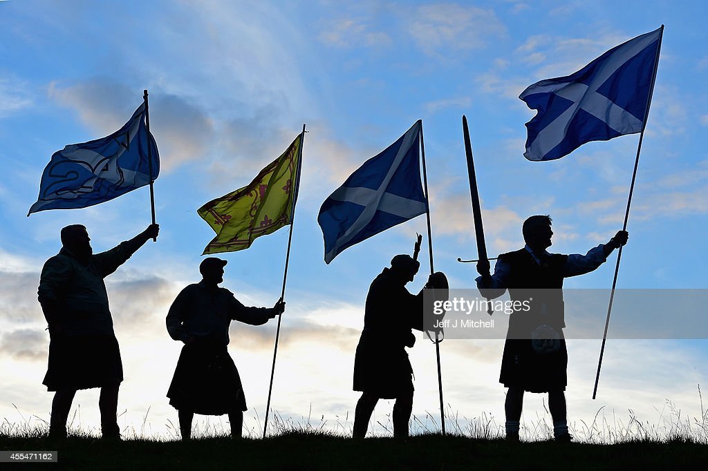 Duncan Thomson, Brian McCutcheon, John Patterson and Arthur Murdoch,from King of Scots Robert the Bruce Society, hold the Scottish flags as they prepare to vote in the Scottish independence referendum on September 14, 2014 in Loch Lomond. The latest polls in Scotland's independence referendum put the No campaign back in the lead, the first time they have gained ground on the Yes campaign since the start of August.