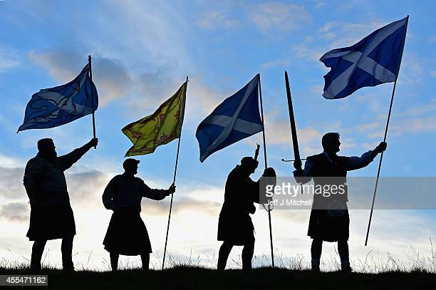 Duncan Thomson Brian McCutcheon John Patterson and Arthur Murdochfrom King of Scots Robert the Bruce Society hold the Scottish flags as they prepare...