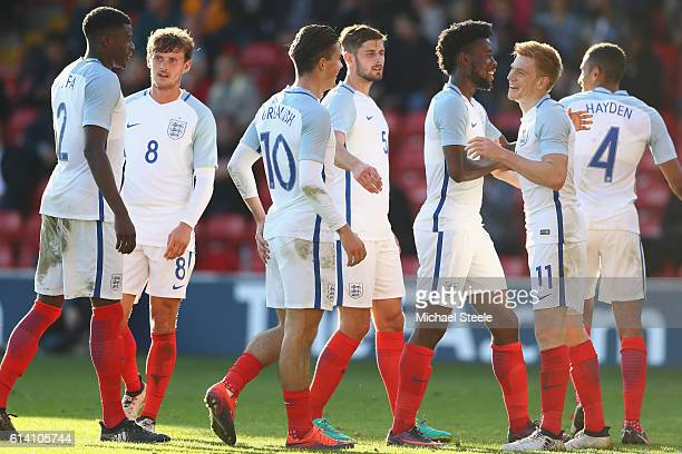 Duncan Watmore of England celebrates his goal alongside Joshua Onomah during the UEFA European U21 Championship Group 9 match between England and...