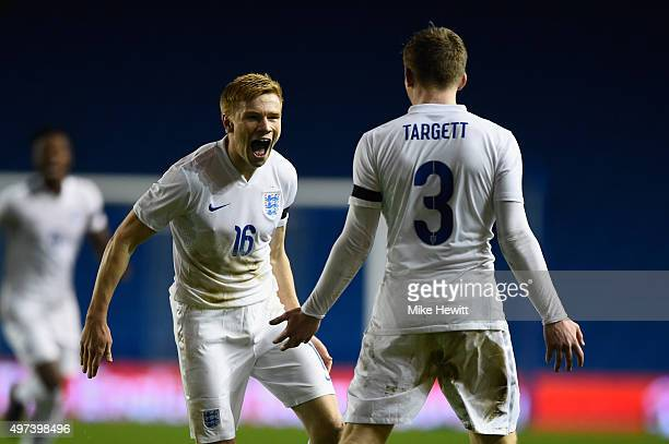 Duncan Watmore of England celebrates with team mate Matt Targett after scoring during a European Under 21 Qualifier between England U21 and...