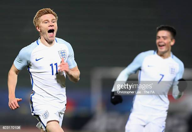 Duncan Watmore of England U21 celebrates with team mate Jack Grealish as he scores their first goal during the U21 international friendly match...