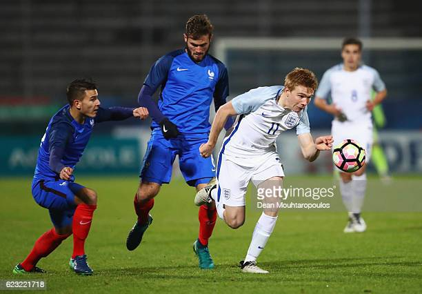 Duncan Watmore of England U21 evades Lucas Hernandez and Lucas Tousart of France U21 during the U21 international friendly match between France and...