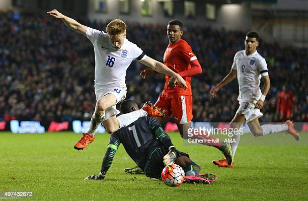 Duncan Watmore of England U21 is brought down by goalkeeper Yvon Mvogo of Switzerland U21 for a penalty which James WardProwse of England U21 scores...