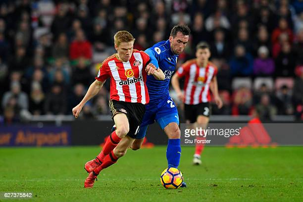 Duncan Watmore of Sunderland and Christian Fuchs of Leicester City battle for the ball during the Premier League match between Sunderland and...