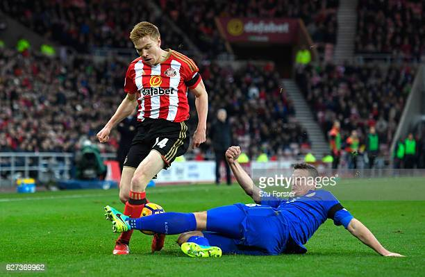 Duncan Watmore of Sunderland is tackled by Robert Huth of Leicester City during the Premier League match between Sunderland and Leicester City at...