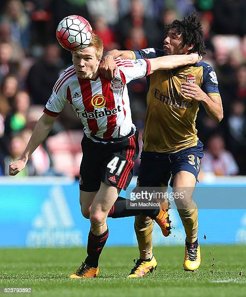 Duncan Watmore of Sunderland vies with Mohamed Elneny of Arsenal during the Barclays Premier League match between Sunderland and Arsenal at The...