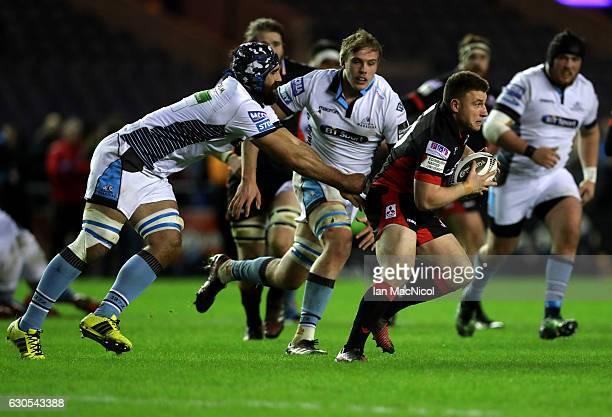 Duncan Weir of Edinburgh evades Josh Strauss of Glasgow during the Guinness Pro 12 match between Edinburgh Rugby and Glasgow Warriors at Murrayfield...