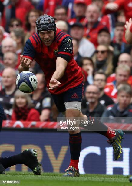 Duncan Williams of Munster passes the ball during the European Rugby Champions Cup semi final match between Munster and Saracens at the Aviva Stadium...