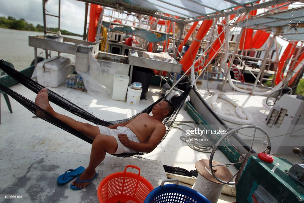 Dund Pham lays in a hammock on the deck of his boat that was hired by BP to help with oil skimming operations after being forced to stay in port due to rough weather on July 6, 2010 in Cocodrie, Louisiana. The bad weather may prevent the skimming operations to continue for a few more days as storm systems spread throughout the Gulf coast region. The boats are hoping to get back to work soon to help contain the Deepwater Horizon spill which has sent millions of gallons of oil into the Gulf since the April 20 explosion on the drilling platform.