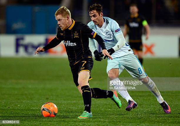 Dundalk's Irish midfielder Daryl Horgan and Zenit St Petersburg's Brazilian midfielder Mauricio vie for the ball during the UEFA Europa League group...