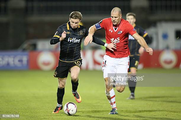 Dundalk's Irish midfielder Ronan Finn attempts to run away from AZ Alkmaar's Dutch defender Ron Vlaar during the UEFA Europa League group D football...