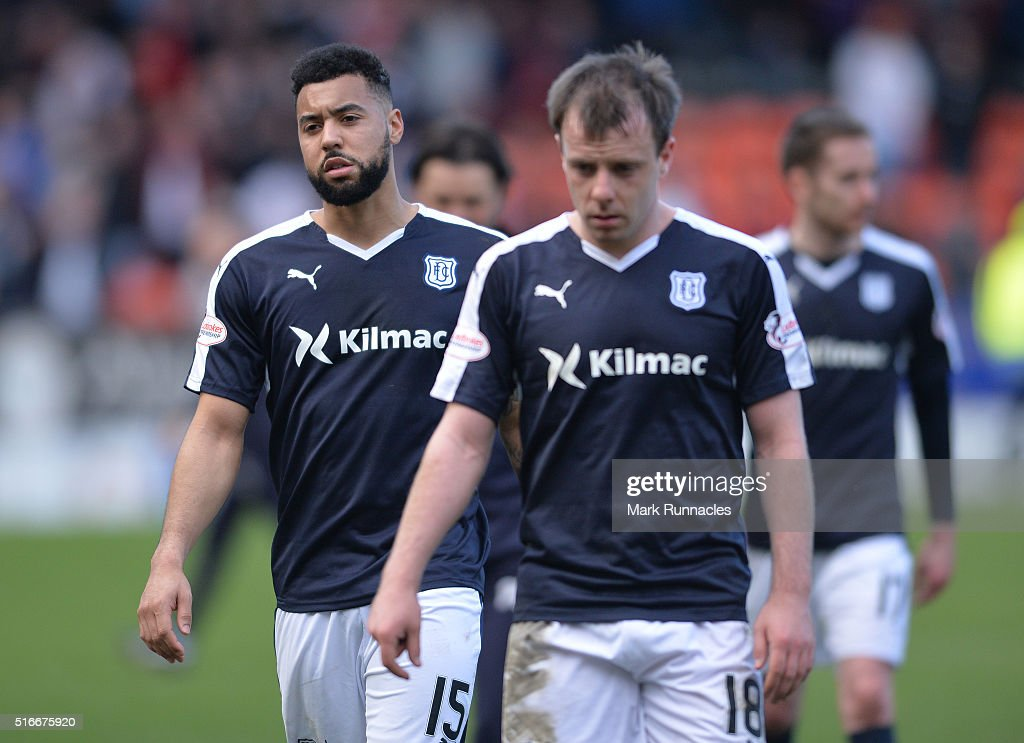 Dundee FC goal scorer Kane Hemmings walk from the pitch after his side lost a two goal lead to rivals Dundee United during the Ladbrokes Scottish...