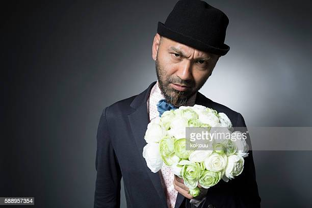 Dundee man with a bouquet for a marriage proposal