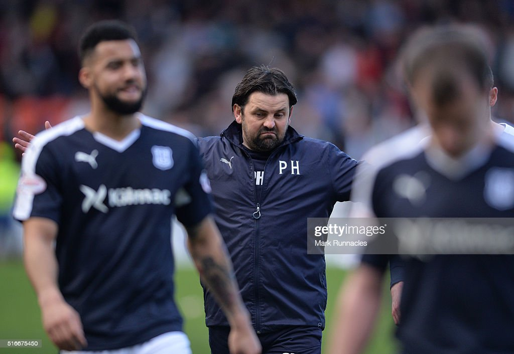 Dundee manager Paul Hartley walk from the pitch after watching his side lose a two goal lead to rivals Dundee United during the Ladbrokes Scottish...