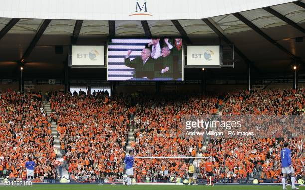 Dundee United chairman Eddie Thompson is seen celebrating his sides second goal on the big screen along with the fans in the crowd
