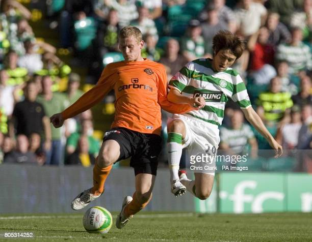 Dundee United defender Scott Robertson battles with Celtic midfielder Koki Mizuno during the Clydesdale Bank Scottish Premier League match at Celtic...