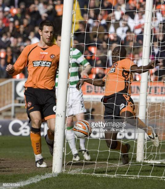 Dundee United midfielder Morgaro Gomis clears the ball off his own line during the Clydesdale Bank Scottish Premier League match at Tannadice Dundee