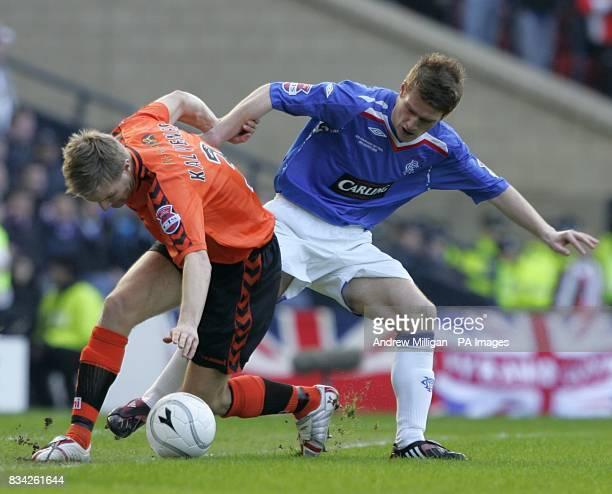 Dundee United's Christian Kalvenes and Rangers' Steven Davis battle for the ball