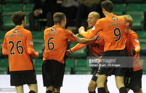 Dundee United's Farid El Alagui celebrates scoring their third goal against Hibernian with Andrew Robertson Paul Paton and Brian Graham during the...