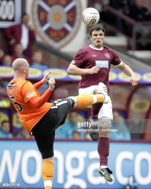 Dundee United's Garry Kenneth challenged by Heart of Midlothian's John Sutton during the Clydesdale Bank Scottish Premier League match at Tynecastle...
