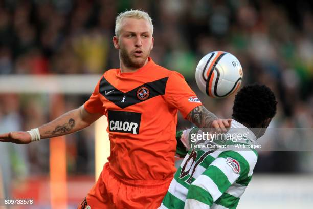Dundee United's Johnny Russell outmuscles Celtic's Victor Wanyama as they battle for the ball