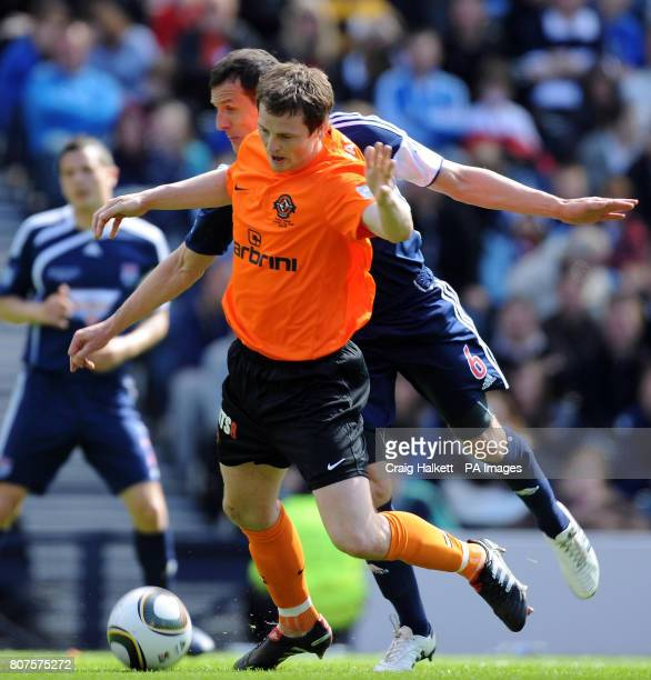 Dundee United's Jon Daly and Ross County's Alex Keddie battle for the ball during the Active Nation Scottish Cup Final at Hampden Park Glasgow