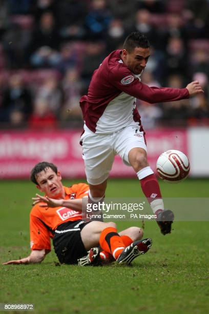 Dundee United's Keith Watson and Heart of Midlothian's Suso Santana in action