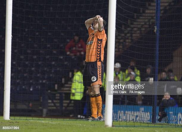 Dundee United's Lee Wilkie reacts after Celtic goalkeeper Artur Boruc saves his penalty during the shoot out following the Cooperative Insurance Cup...