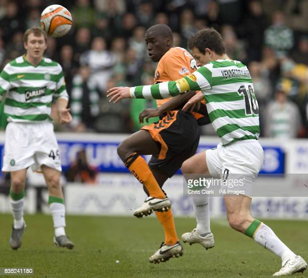 Dundee United's Morgaro Gomis holds off Celtic's Jan Vennegoor of Hesselink during the Clydesdale Bank Scottish Premier League match at Tannadice...