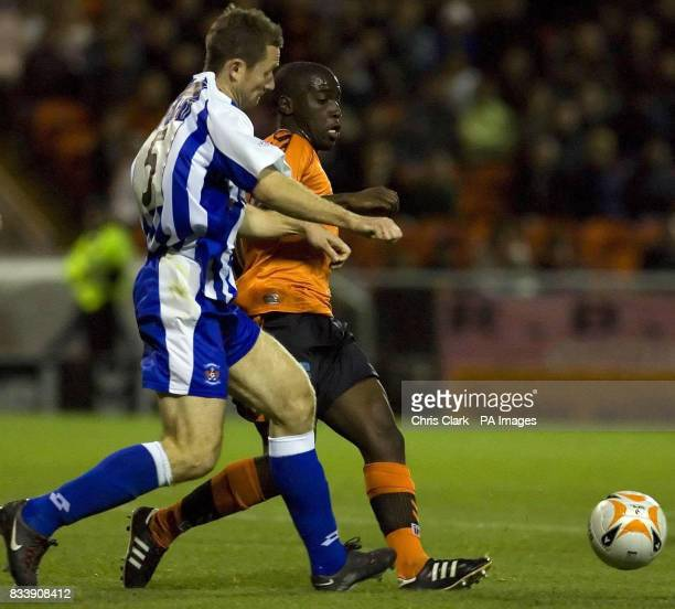 Dundee United's Morgaro Gomis is tackled by Kilmarnock's Frazer Wright during the Clydesdale Bank Scottish Premier League match at Tannadice Park...