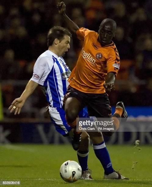Dundee United's Morgaro Gomis is tackled by Kilmarnock's James Fowler during the Clydesdale Bank Scottish Premier League match at Tannadice Park...