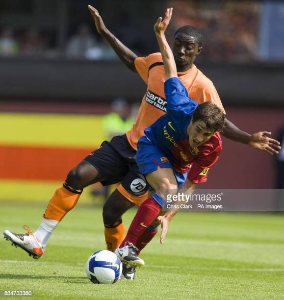 Dundee United's Morgaro Gomis looks to tackle Bojan Kirkic Perez of FC Barcelona during the PreSeason Friendly at Tannadice Park Dundee