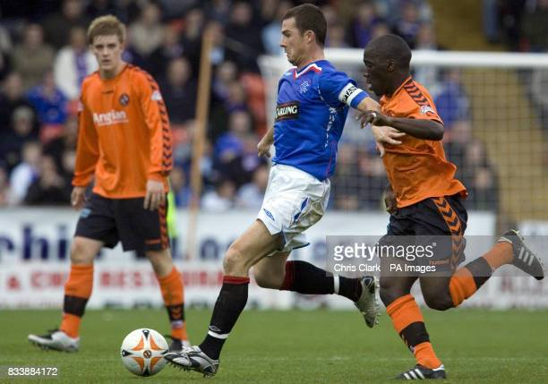 Dundee United's Morgaro Gomis looks to tackle Rangers' Barry Ferguson during the Clydesdale Bank Scottish Premier League match at Tannadice Park...