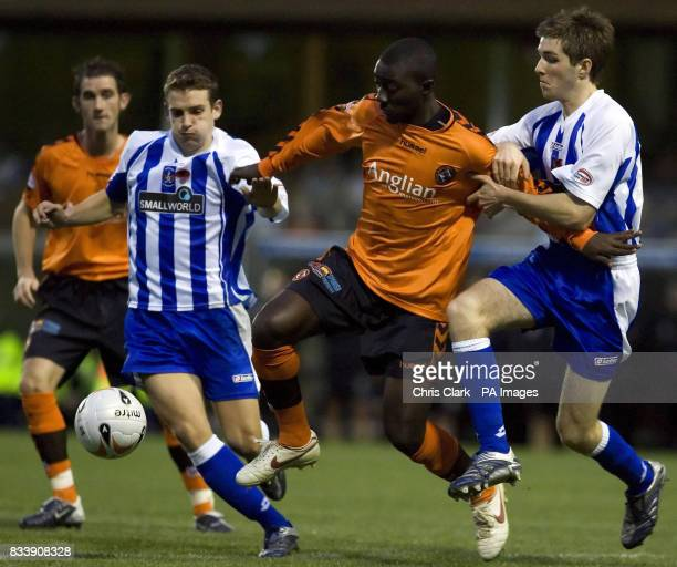Dundee United's Morgaro Gomis tussles with Kilmarnock's Craig Bryson and Iain Flannigan during the Clydesdale Bank Scottish Premier League match at...