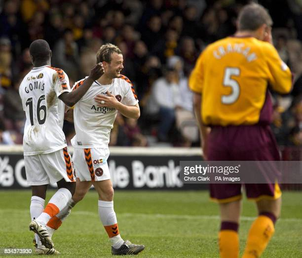 Dundee Utd's Morgaro Gomis and Noel Hunt celebrate after Motherwell's Stephen Craigan headed the ball into his own goal during the Clydesdale Bank...
