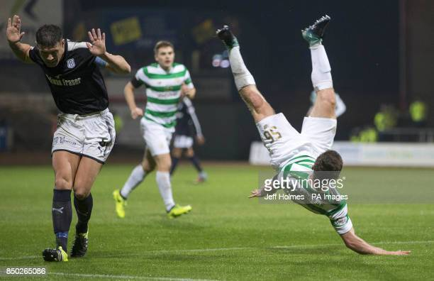 Dundee's Darren O'Dea challenges Celtic's Anthony Ralston during the Betfred Cup Quarter Final match at Dens Park Dundee