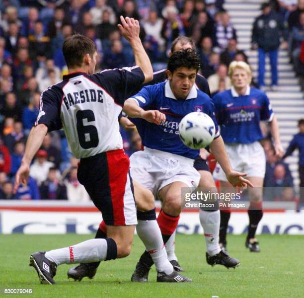 Dundee's Robbie Raeside slides in to take the ball off Ranger's Rino Gattuso during the match at Ibrox today EDI Photo by Chris Bacon/PA