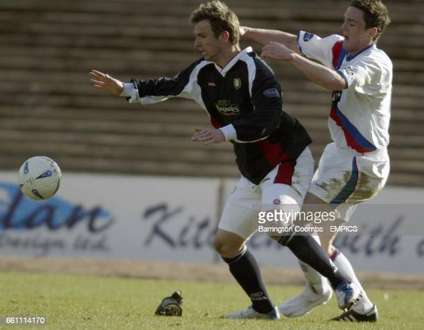 Dundee's Steve Lovell and Rangers' Maurice Ross minus his right boot battle for the ball