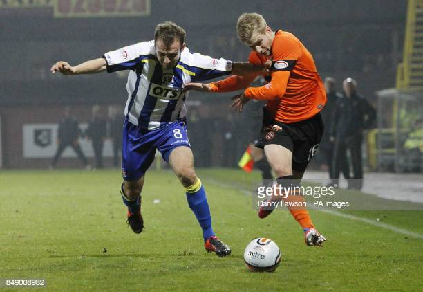 Dundee's Stuart Armstrong and Kilmarnock's Liam Kelly fight for the ball during the Clydesdale Bank Scottish Premier League match at Tannadice Park...