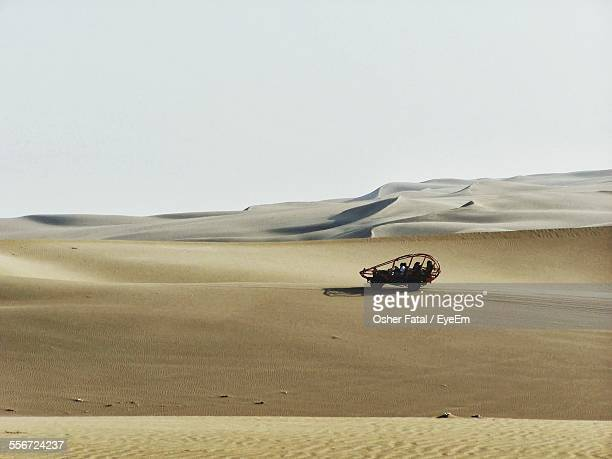 Dune Buggy In Desert