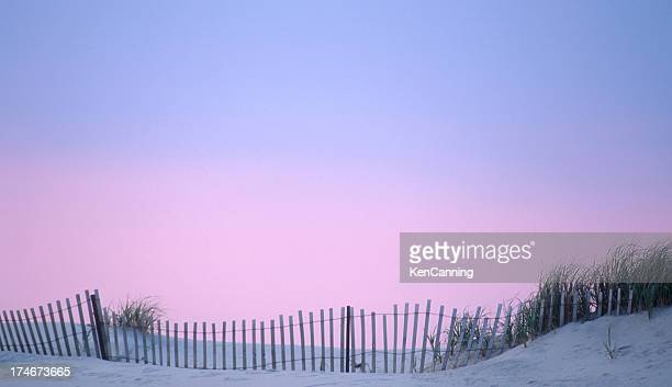 Dune Fence on the Beach with Sunset Sky