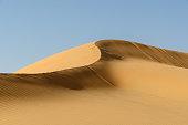 Middle East desert – dune ridge in the Liwa Desert, which is part of the Rub al Khali Desert or Empty Quarter desert, straddling UAE, Oman, Yemen and Saudi Arabia