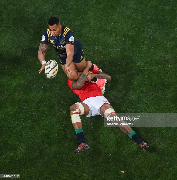 Dunedin New Zealand 13 June 2017 Tevita Li of the Highlanders is tackled by Courtney Lawes of the British Irish Lions during the match between the...