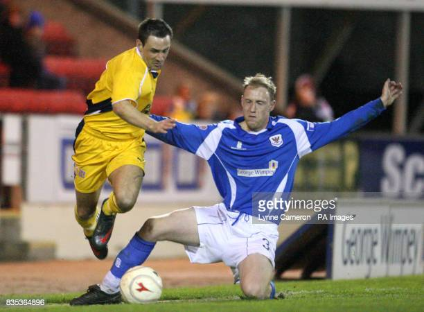 Dunfermline Athletic's David Graham and St Johnstone's Steven Anderson battle for the ball