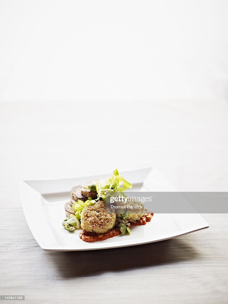 Dungeness crab cakes served with romesco sauce