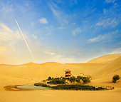 Yueya Spring is a crescent-shaped lake in an oasis, 6 km south of the city of Dunhuang in Gansu Province, China.