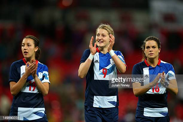 Dunia Susi Ellen White and Claire Rafferty of Great Britain applaud the fans as they celebrate their team's victory after the Women's Football first...