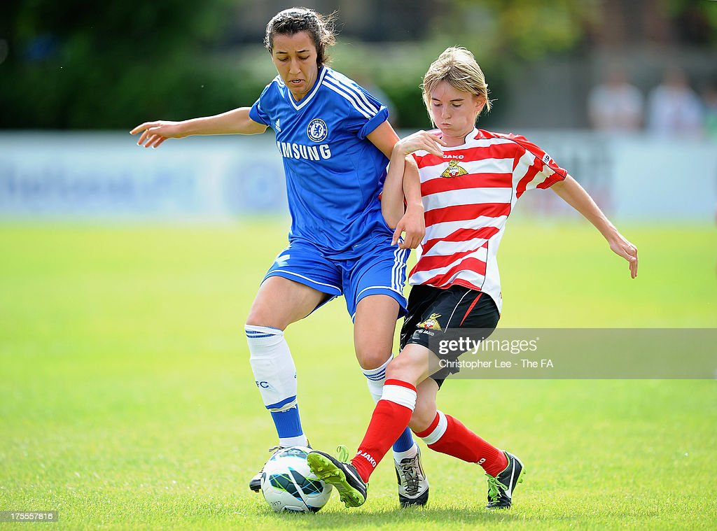 Dunia Susi of Chelsea battles with Ashleigh Mills of Doncaster during The FA Women's Super League match between Chelsea Ladies and Doncaster Rovers Belles Ladies at Wheatsheaf Park on August 4, 2013 in Staines, England.